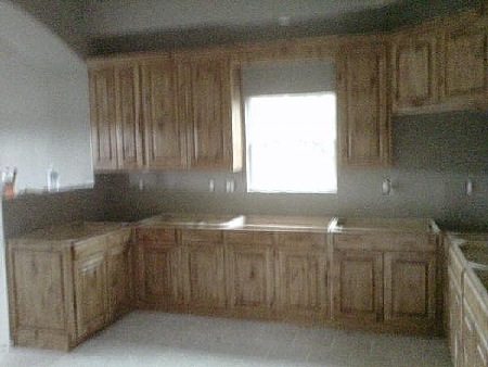 These Kitchen Cabinets Feature Knotty Alder Wood With An
